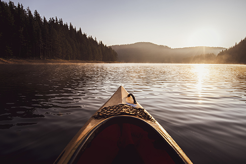 Kayaking at the sunrise light in the White Mountains.